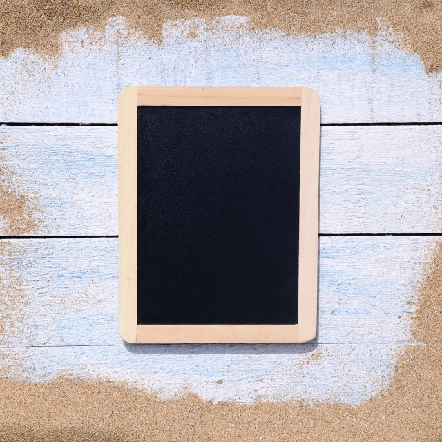 """Blackboard on beach."" stock image"