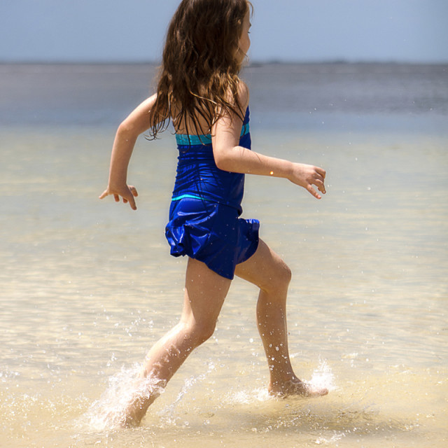 """Girl running in water"" stock image"