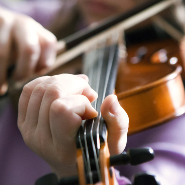 """Young Girl Playing the Violin"" stock image"