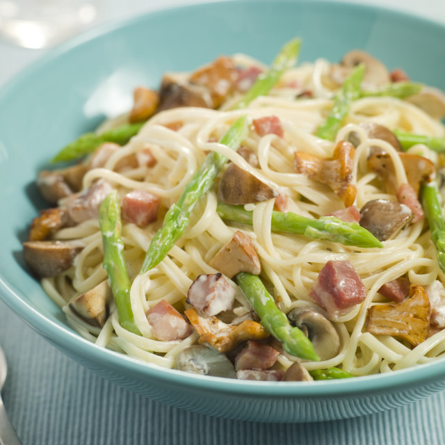 """""""Linguine with Girolle Mushrooms Asparagus and Pancetta"""" stock image"""