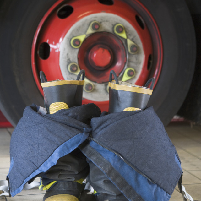 """""""Firefighter's boots and trousers in a fire station"""" stock image"""