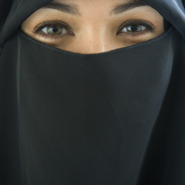 """""""Portrait of a middle eastern woman wearing a black hijab"""" stock image"""
