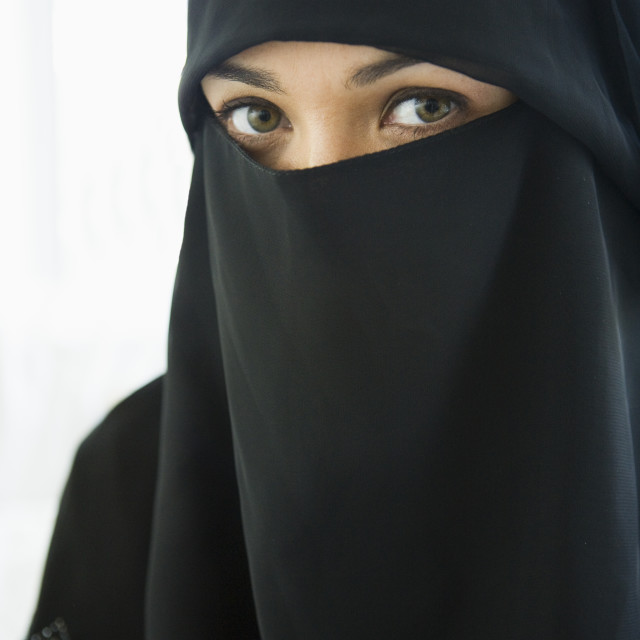 """Portrait of a middle eastern woman wearing a black hijab"" stock image"