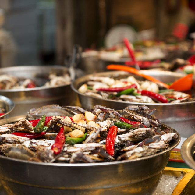 """Bowls of fish with chillies and garlic at Kwang Jang Market, Seoul, South Korea"" stock image"
