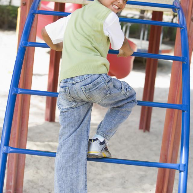 """Boy on climbing frame"" stock image"