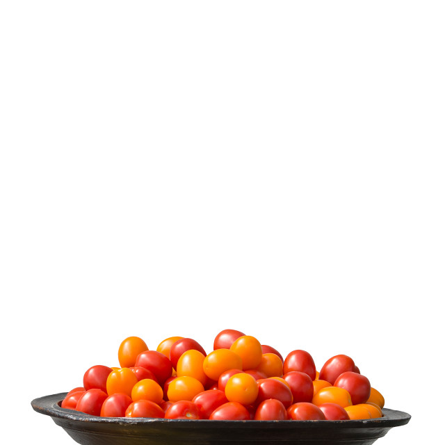 """Tomatoes red and yellow on large plate"" stock image"