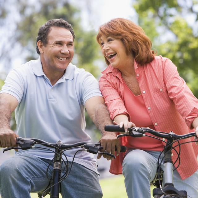"""Mature couple bike riding."" stock image"