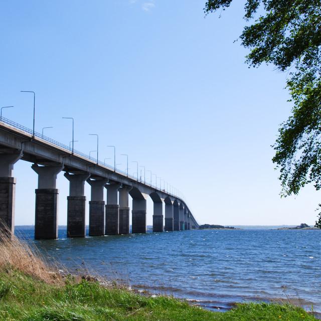 """Bridge over blue water"" stock image"