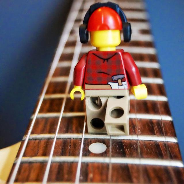 """Lego Man Strumming"" stock image"
