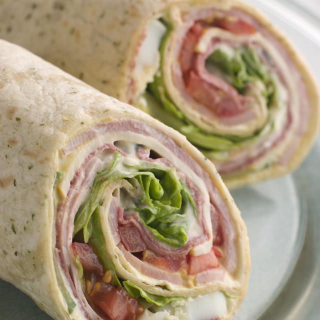 """Deli Tortilla Wrap Cut in Half"" stock image"
