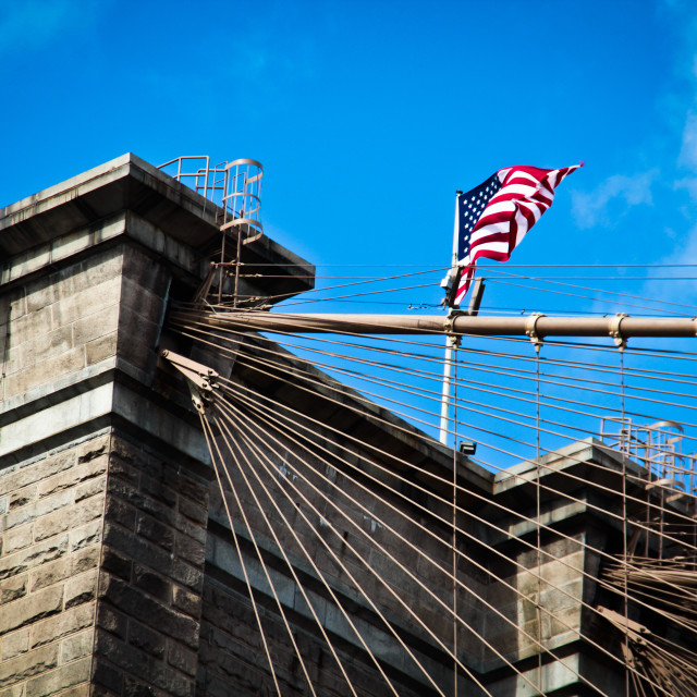 """American flag on Brooklyn Bridge"" stock image"