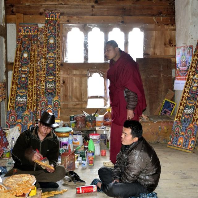 """Artist in action in Gangtey Monastery, Bhutan"" stock image"
