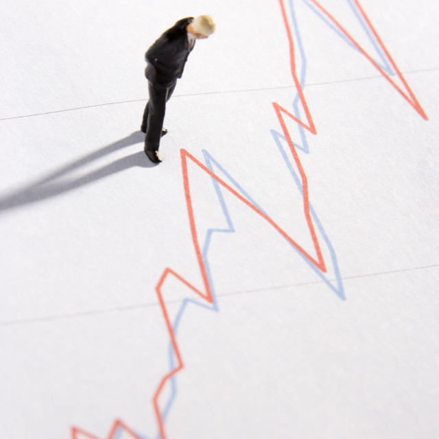"""""""Figurine Of A Businessman Standing On A Line Graph"""" stock image"""