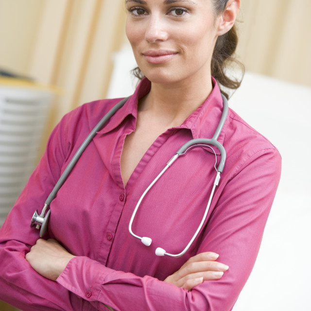 """A Doctor Standing In A Hospital Ward"" stock image"