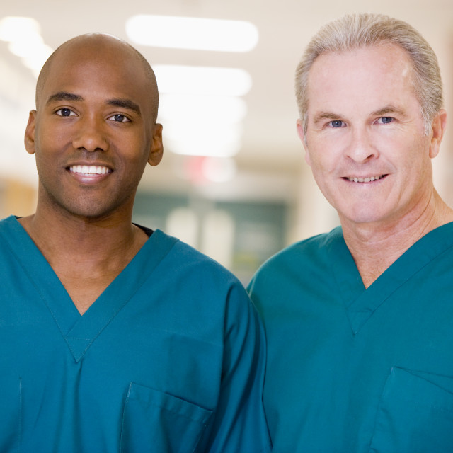 """""""Two Orderlies Standing In A Hospital Corridor"""" stock image"""