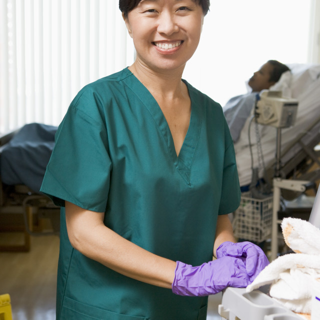 """""""An Orderly Cleaning A Hospital Ward"""" stock image"""