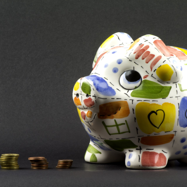 """Piggy bank with coins"" stock image"