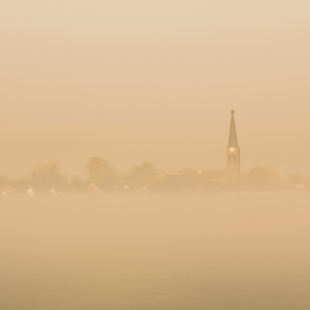 """""""A typical dutch village in the foggy golden morning light."""" stock image"""