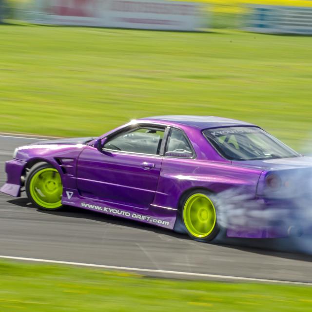 """Nissan Skyline R34 GTR drifting"" stock image"