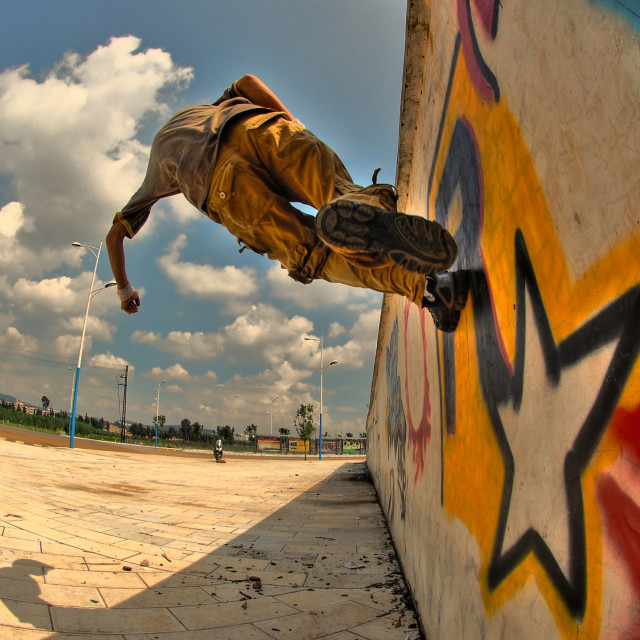 """Parkour in China: running up a wall"" stock image"