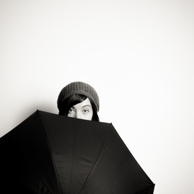 """Young pretty woman with umbrella"" stock image"