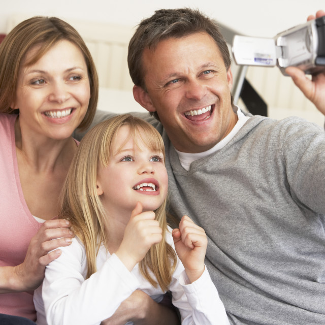 """""""Parents And Daughter With Video Camera"""" stock image"""