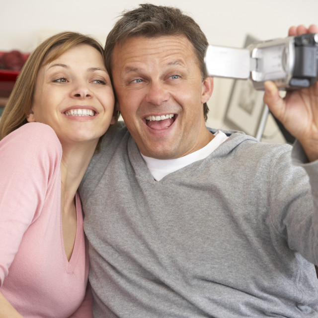 """""""Couple With Video Camera"""" stock image"""