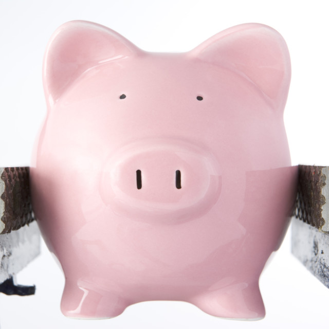 """""""Piggy bank in jaws of vice"""" stock image"""