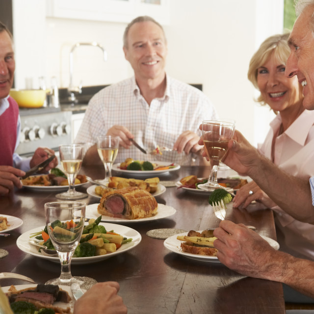 """Friends Enjoying Lunch At Home Together"" stock image"