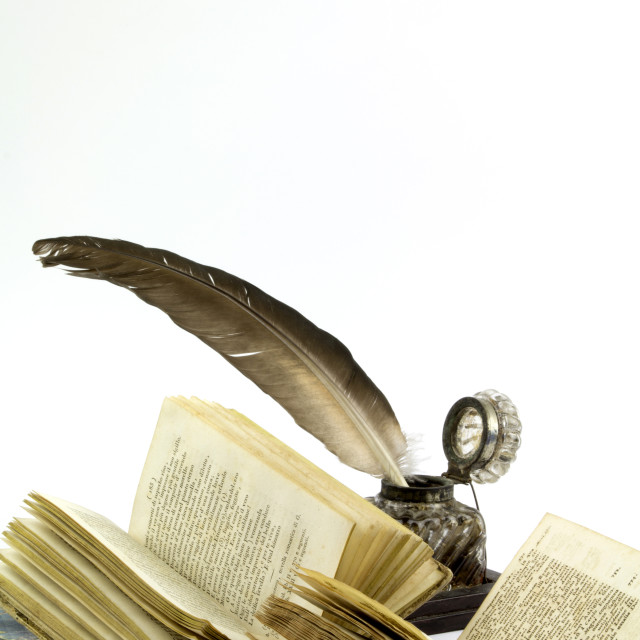 """Ink pot, quill and old books"" stock image"