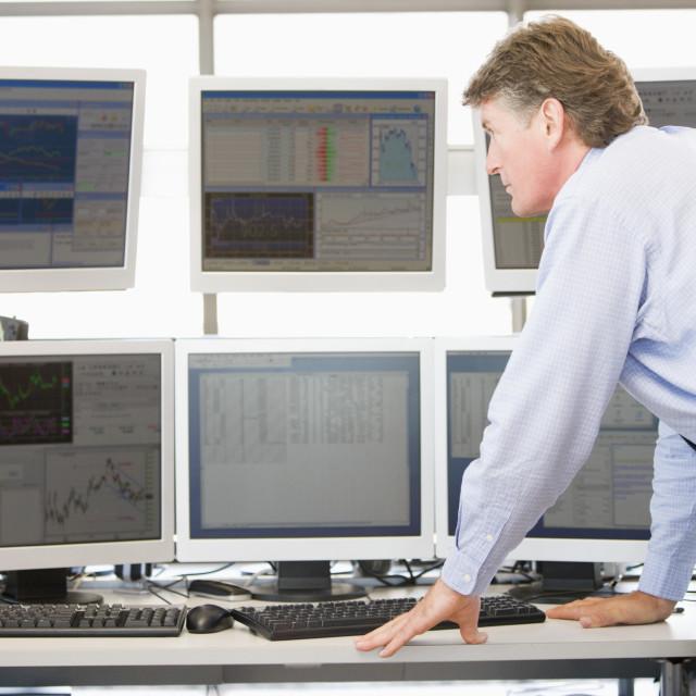 """""""Stock Trader Examining Computer Monitors"""" stock image"""