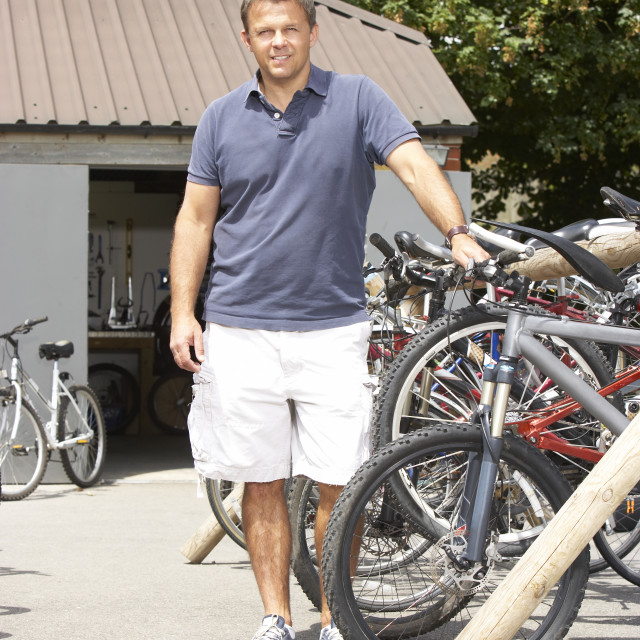 """""""Owner of cycle shop in workshop"""" stock image"""