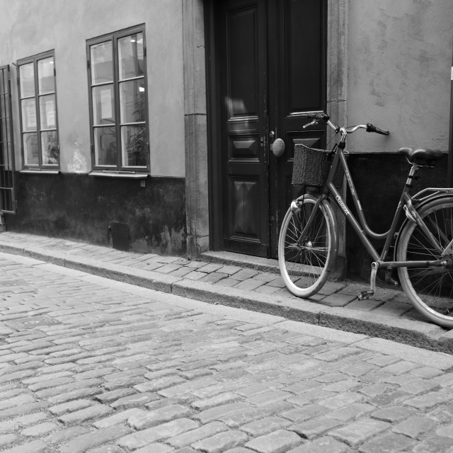 """""""A bicycle in the alley in Stockholm in black and white"""" stock image"""