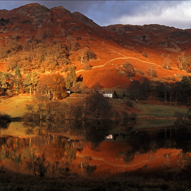 """Late afternoon sun at Loughrigg Tarn"" stock image"