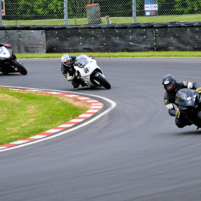 """A Motorcycle Race on a corner"" stock image"