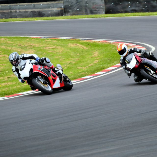 """Two Racing Motorcycles cornering hard"" stock image"