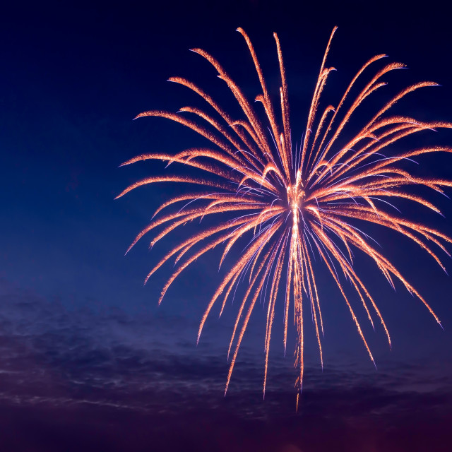 """Aerial firework exploding on a calm summers evening"" stock image"