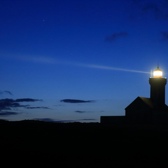 """""""Les Poulains lighthouse at night"""" stock image"""