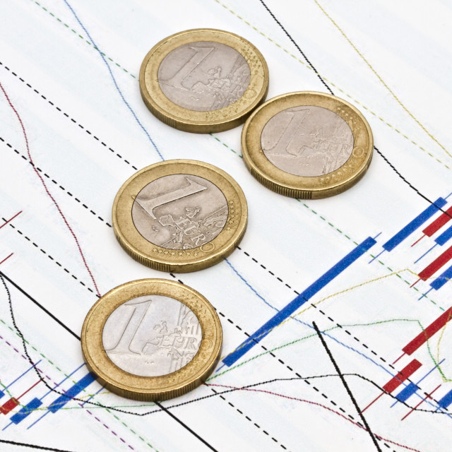 """Euro coins on business graph background"" stock image"