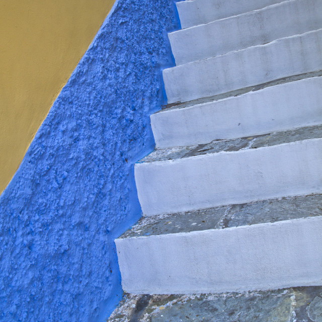 """White stairs and blue wall"" stock image"