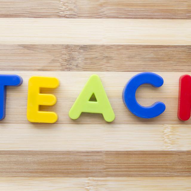 """Letter magnets ""TEACH"""" stock image"