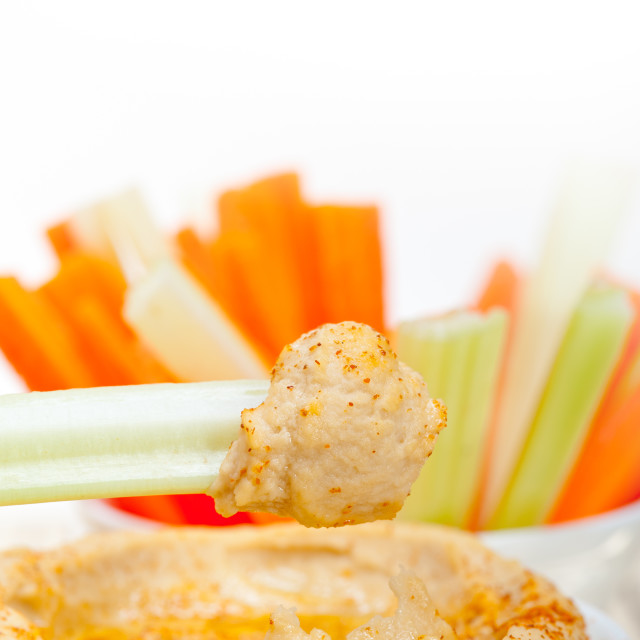 """fresh hummus dip with raw carrot and celery"" stock image"