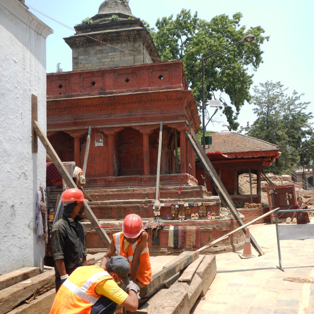 """""""workers cutting boards to strengthen damaged temples by earthquake, Kathmandu, Nepal"""" stock image"""
