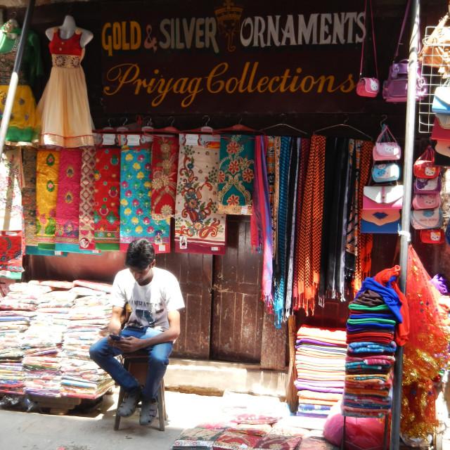 """shop keeper in front of his garments shop, Kathmandu, nepal"" stock image"