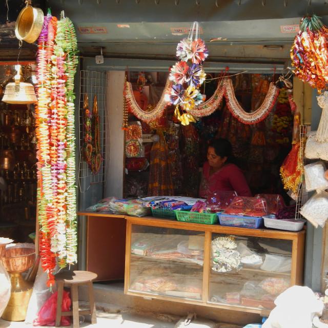 """shop keeper in her decoration shop in kathmandu"" stock image"