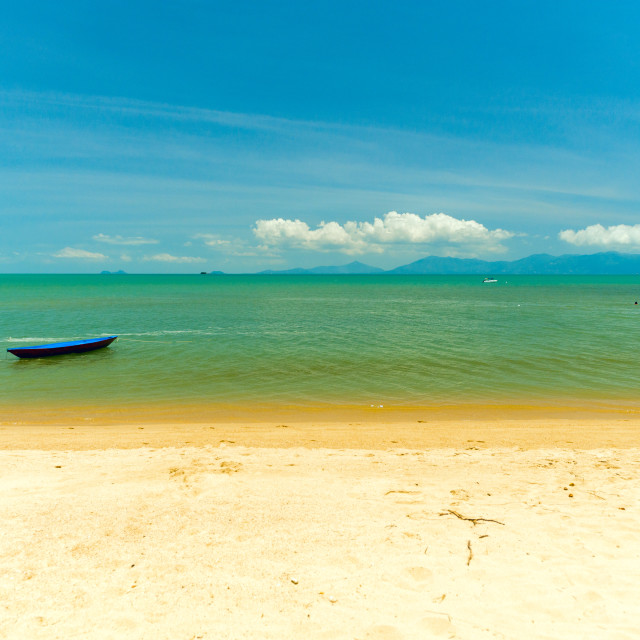 """""""Boat at the edge of a tropical beach"""" stock image"""