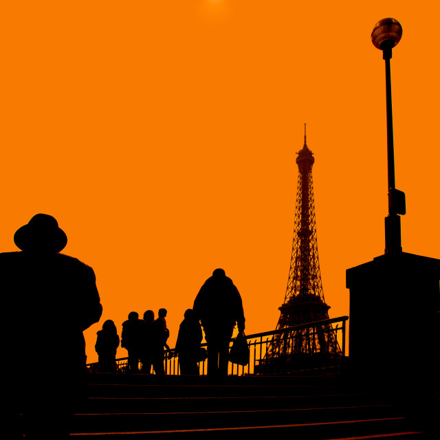 """Walking people in silhouette"" stock image"