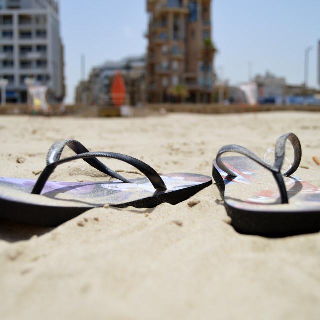 """Flip flops in the sand"" stock image"
