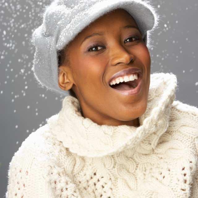 """Fashionable Woman Wearing Knitwear And Cap In Studio"" stock image"