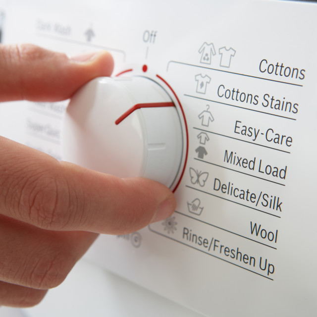 """""""Close up of clothes washer dial"""" stock image"""